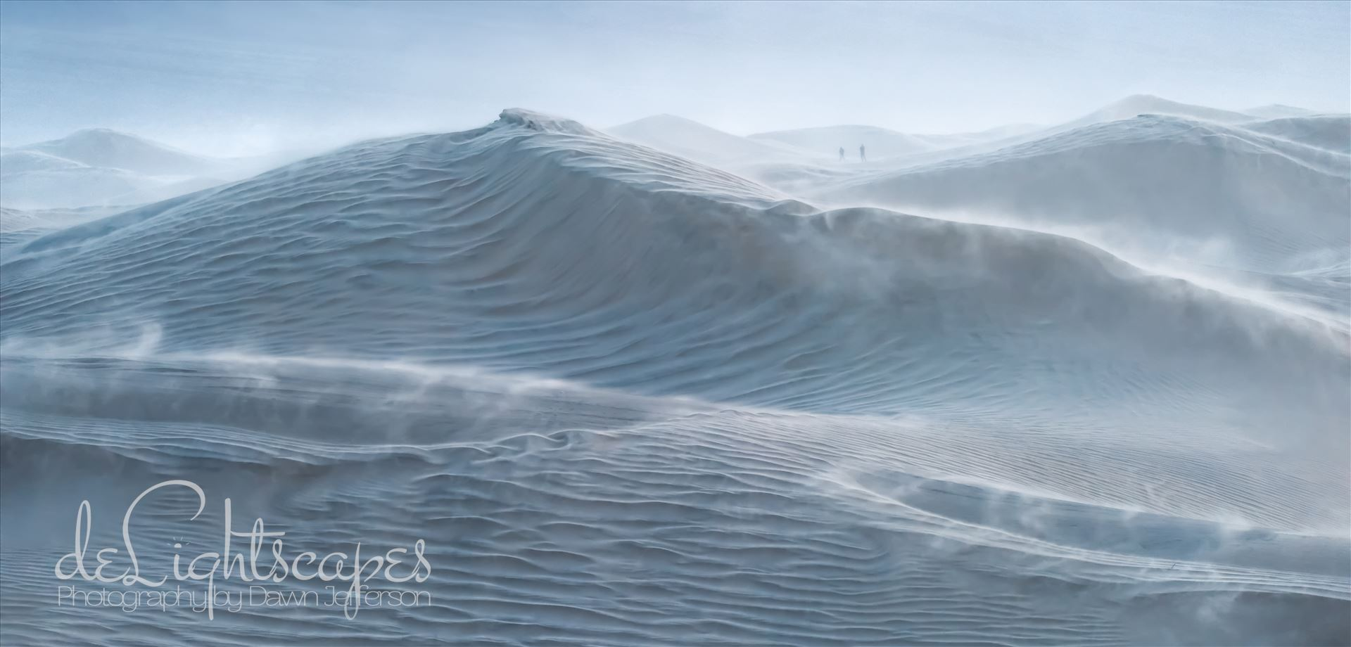 Rough Seas - Mesquite Dunes at blue hour during a wind storm with 30 mph sustained winds and 50-60 mph gusts. The dunes looked like a storm tossed sea especially the large dune which appears to be a cresting wave and the blowing sand is reminiscent of sea spray. by Dawn Jefferson