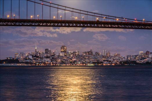 San Francisco by Moonlight - A full moon rises above the Golden Gate Bridge illuminating the San Francisco skyline.