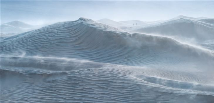 Rough Seas - Mesquite Dunes at blue hour during a wind storm with 30 mph sustained winds and 50-60 mph gusts. The dunes looked like a storm tossed sea especially the large dune which appears to be a cresting wave and the blowing sand is reminiscent of sea spray.